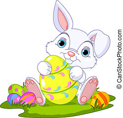 Easter Bunny with Easter Egg - Cute Easter Bunny holding...