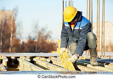 construction worker preparing formwork - construction worker...