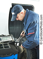 machanic repairman at tyre balancing adjustment - mechanic...