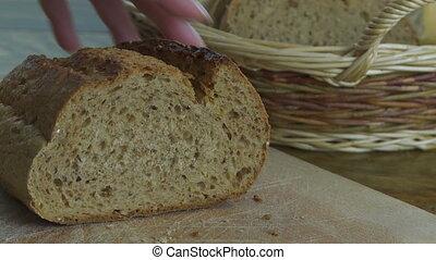 Slicing Rye Bread - Cutting a piece of rye bread