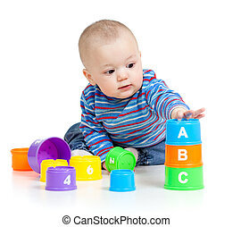 baby is playing with educational toys, isolated over white -...