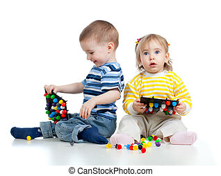 Children playing with  mosaic toy