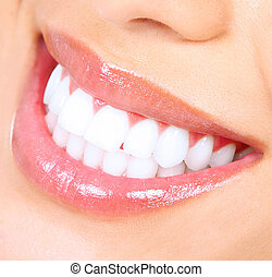 Teeth whitening. Woman smile.