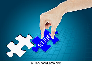 Hand inserting missing solution jigsaw puzzle