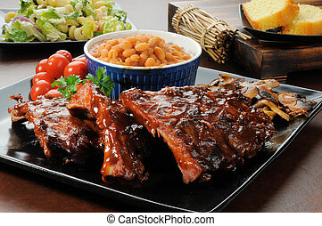 Barbecue Ribs - Racks of barbecue ribs drenched in sauce...
