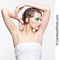 woman with creative hairdo - sideview portrait of beautiful...