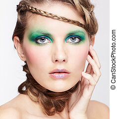 woman with creative hairdo - portrait of beautiful young...