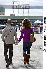 Couple walking down to Public Market, Seattle. - Couple...