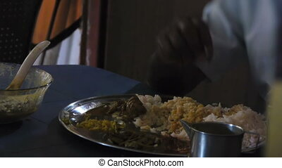 Indian man eats with hands