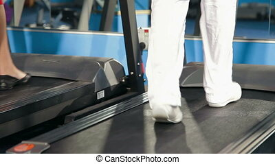 Treadmill Workout - People working out on treadmills