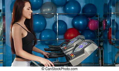 Work Out On Treadmill In The Gym - Young Woman Training On...