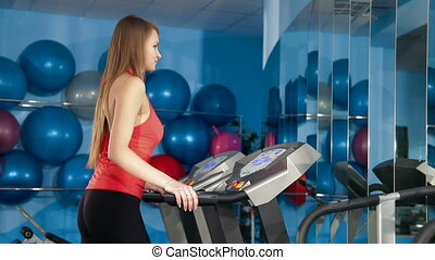 Work Out On Treadmill In The Gym - Young Girl Training On...