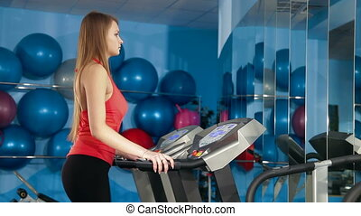 Young Girl On Treadmill In The Gym