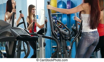 Exercise At The Gym - Two Young Women Exercising In The Gym...