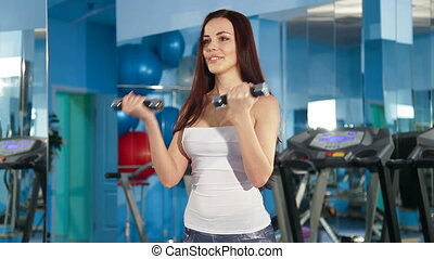 Weight Training At The Gym - Young Woman Working Out With...