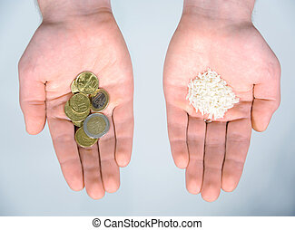 Food is money - money is food - Hands holding coins and rice