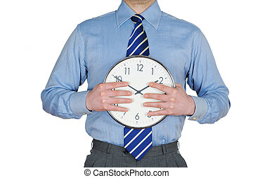 Time Management - Young businessman holding a clock