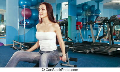 Young Women Exercising At The Gym - Two Young Women...
