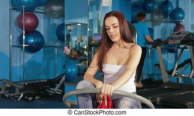 Young Woman At The Gym - Young Woman Exercising At The Gym....