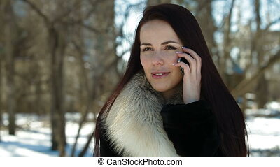 Young Woman On The Phone In Winter