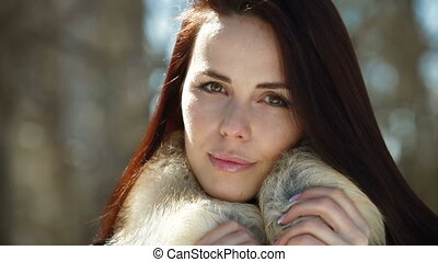 Face Of Young Woman in Fur - A Beautiful Fashion Model...