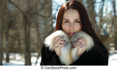 Beauty In Fur - A Beautiful Fashion Model Smiling and...