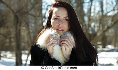 Beautiful Girl In Fur Coat Looking At Camera