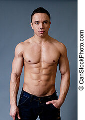 Sexy naked torso fit and neat young man studio portrait...