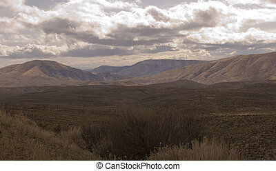 Vista of foothills of Cascade Mountains, sagebrush in...