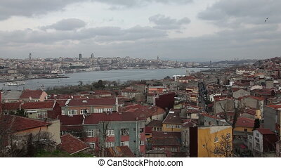 golden horn at the istanbul - passenger ship passing golden...