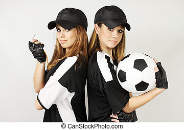 Two soccer coaches with the ball and the whistle