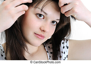 beautiful young woman touching her hair