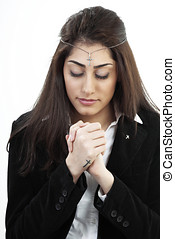 Girl in prayer - Devout young woman praying with the holy...