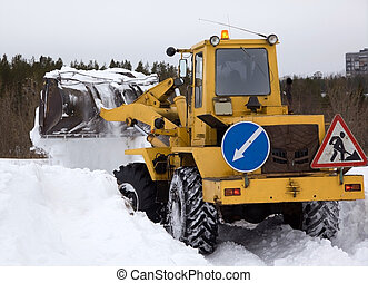 The tractor clears snow from the road blockage Heavy special...