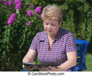 A woman with an e-book