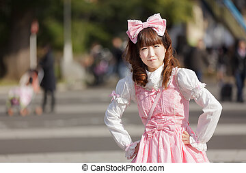 japanese lolita - lolita cosplay woman in harajuku park,...