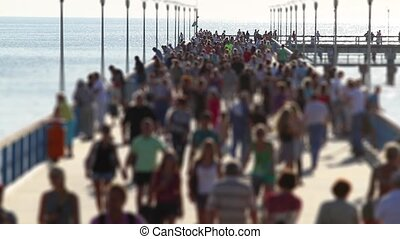 crowded pier, tilt-shift