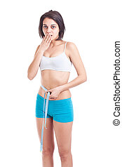 Young slim woman measuring