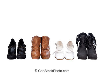 Four pairs different shoes over white background