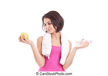 Smiling girl holding bottle of water and apple over white...