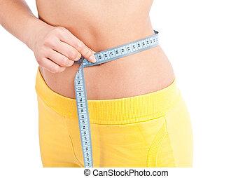 Girl measuring size