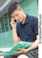 Portrait of businessman calling by phone