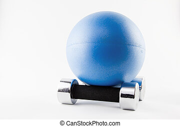 Blues Fitness ball position on two silver hand weights