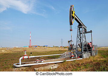 the oil derrick - a single oil derrick in the summer on the...
