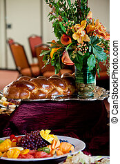 challah bread and flowers - challah set out during a kiddush...
