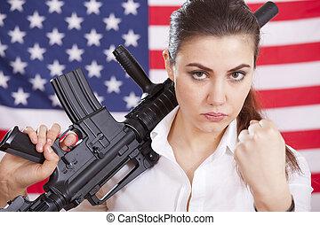 woman with machine gun threatening