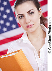 woman with folder over american flag