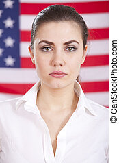 portrait of woman over american flag