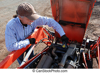Removing radiator cap on tractor