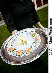 waiter serving food during a catered event